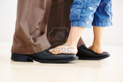 9474600-closeup-of-father-carrying-son-on-his-feet